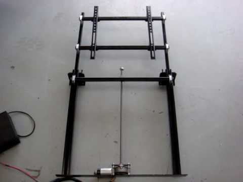 Lci tv lift in operation youtube for Motorized vertical tv lift