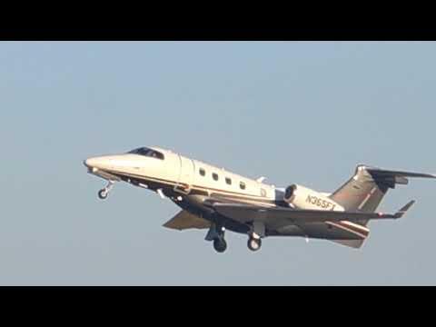 Flight Options Embraer Phenom 300 Taking Off From Manassas Reginal Airport (HEF)