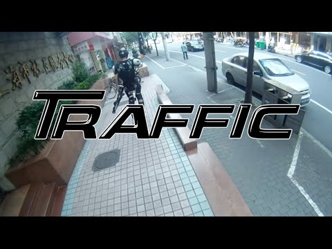 TRAFFIC.  Rollerman on the road in China (Lishui Ep 10)