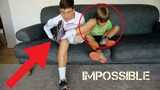 TRYING TO TAKE OFF FOOTBALL BOOTS AND SOCKS WITHOUT HANDS (FORFEIT)