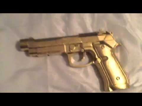 Pistol Spray Painted Gold You