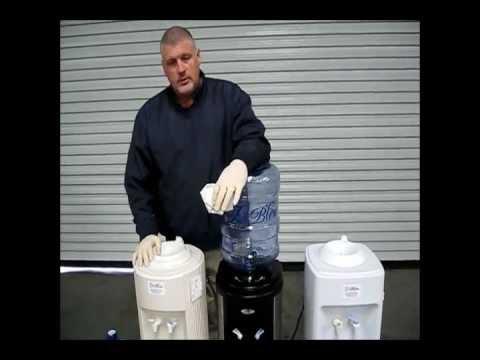 Oasis bpd1shs 503998c white cabinet bottled water cooler.