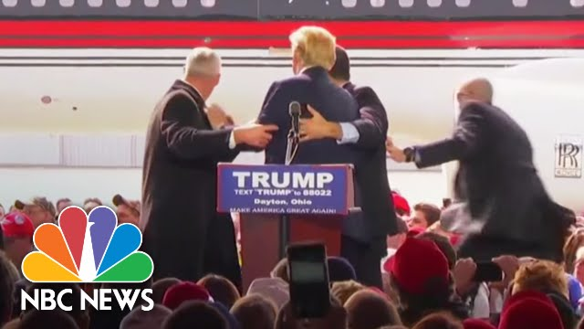 Secret Service Agents Rush Stage to Protect Donald Trump At Rally | NBC News