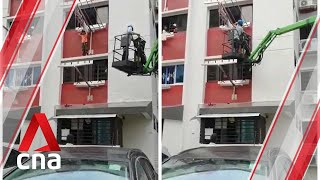 Child rescued from ledge of housing block in Hougang, Singapore