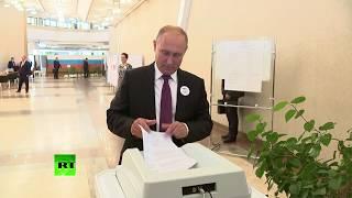 ВЫБОРЫ-2018. Путин дважды неправильно установил бюллетень в КОИБ