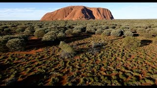 Never before seen bird's-eye view of Uluru These spectacular birds-eye views of Uluru, offering a never before seen perspective of the 600 million year old monolith, were captured by the first drone to ever operate under permit inside Uluru-Kata Tjuta National Park.  Uluru is the tip of a huge rock that continues below the ground for possibly 5-6km.  Uluru is 3.6km long and 348m at its tallest point. That is 43m higher than Sydney's Centrepoint Tower, 24m higher than the Eiffel Tower and just 33m lower than the Empire State Building.    The colour changes of Uluru result from the filtering effect of the earth's atmosphere on the sun's rays.  Explore more at www.ayersrockresort.com.au  Music: 'After the Rain' by Tim Hempton