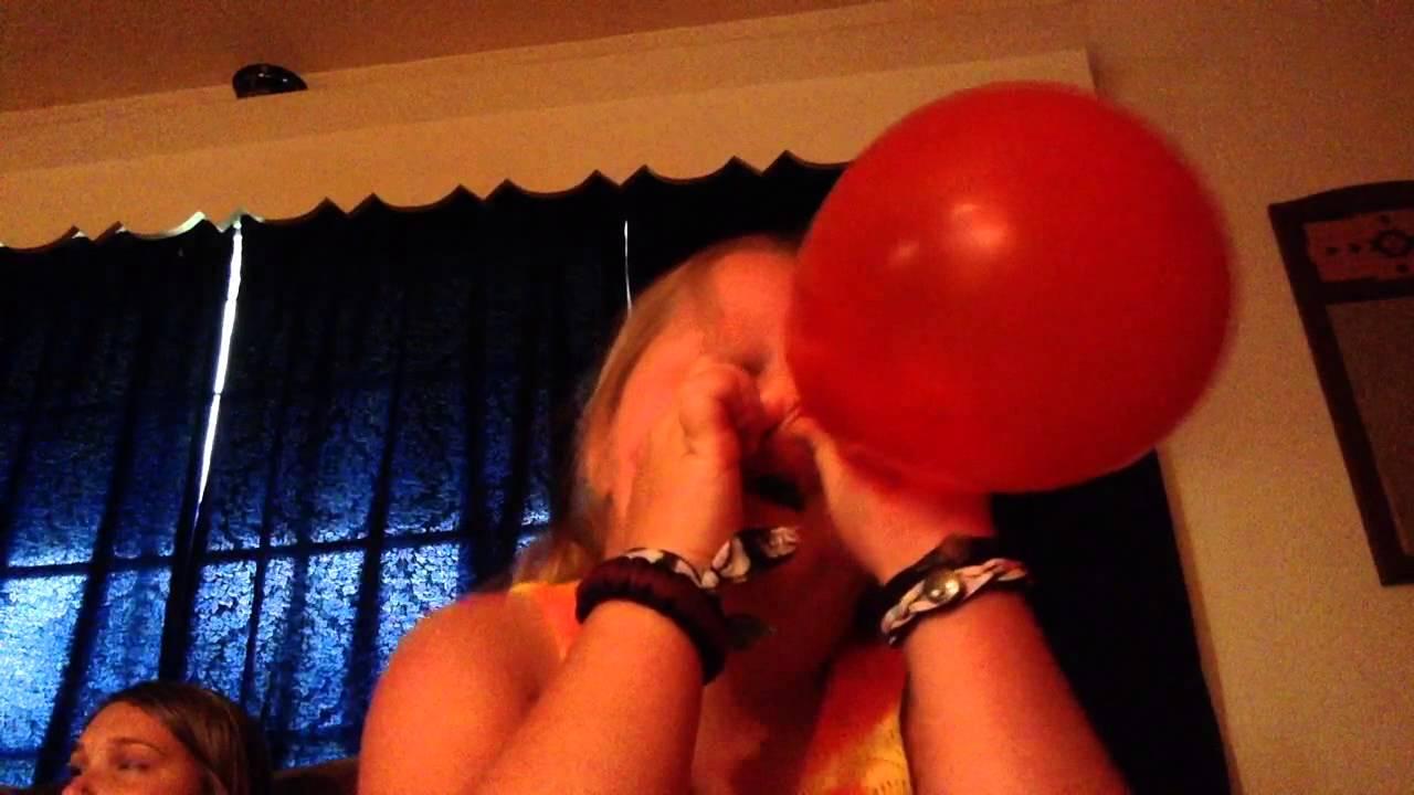 Girl blows up balloon with vagina