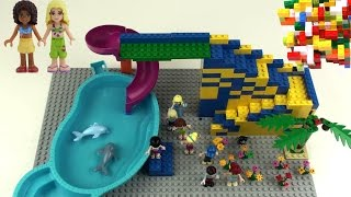 Lego Friends 2 + slide + dolphin + swimming pool + Mia + Olivia + Emma + Andrea +Stephanie