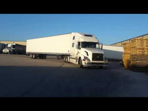 How to back up a semi truck.  Woman truck driver backing up semi truck.