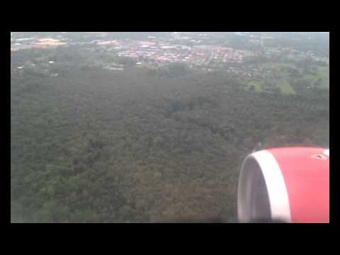 Airbus A320-200 with Airasia landing in Sandakan,Sabah by rainy weather,but nice landing.