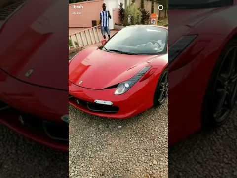 Ibrah relaxing in his Ferrari