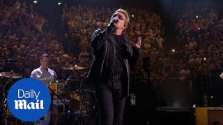 'We are all Parisians' Bono pays tribute during U2 concert - Daily Mail