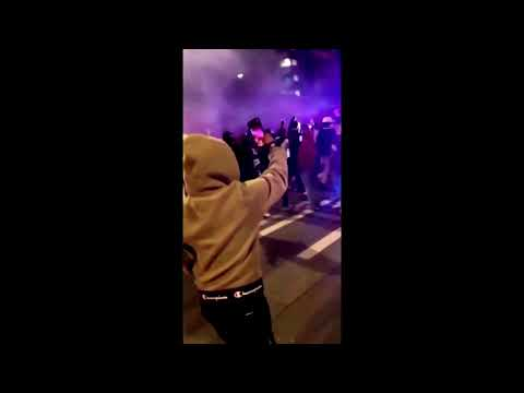 Police car charges Tacoma crowd watching street race