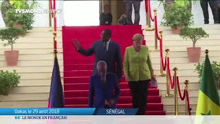 Theresa May et Angela Merkel en tournée africaine