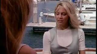 Kathy showing belly button in Melrose Place