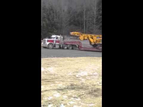 Falzones haul drill rig