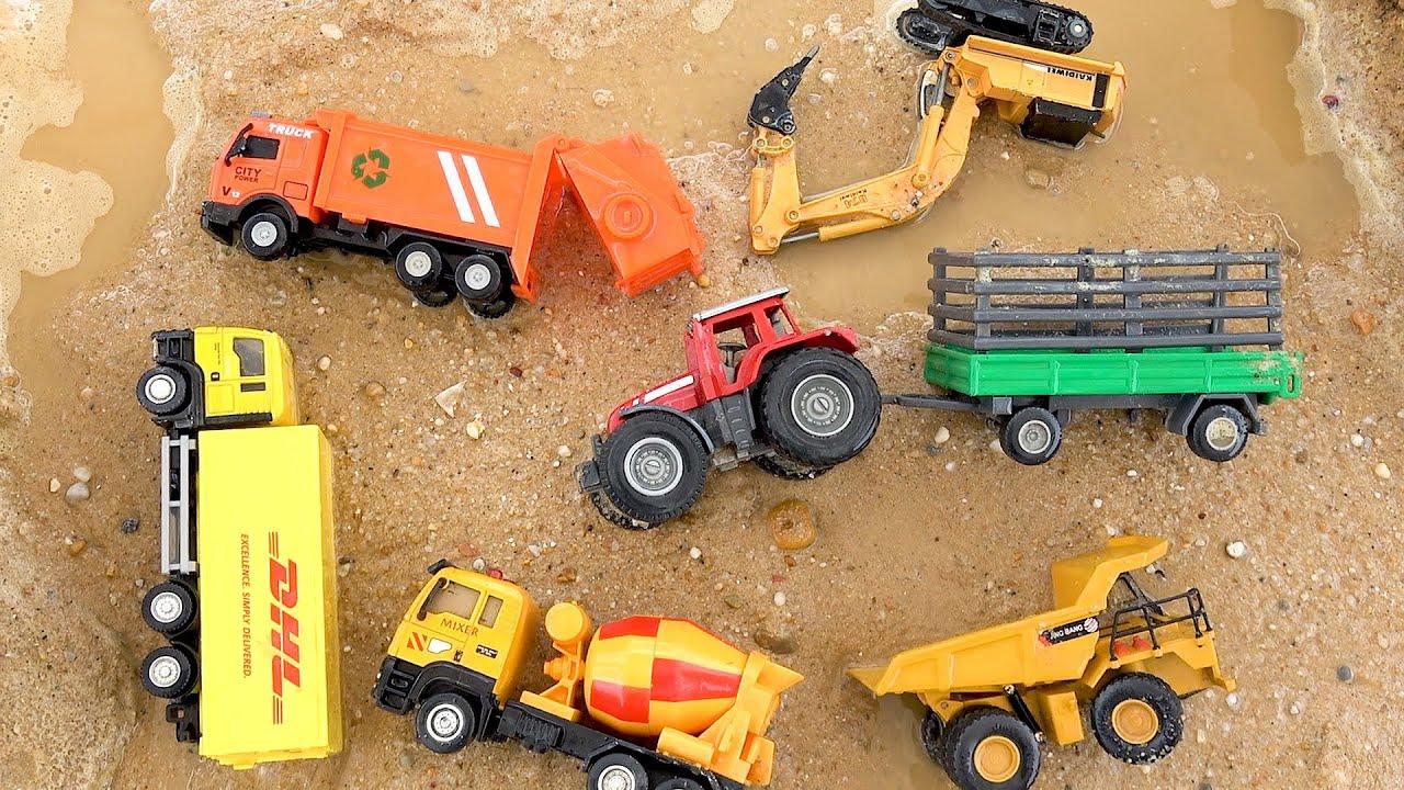 Construction Vehicles Under the Mud. Excavator Dump Truck Tractor Cement Mixer
