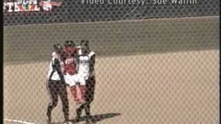Softball player carried around bases by opponents thumbnail