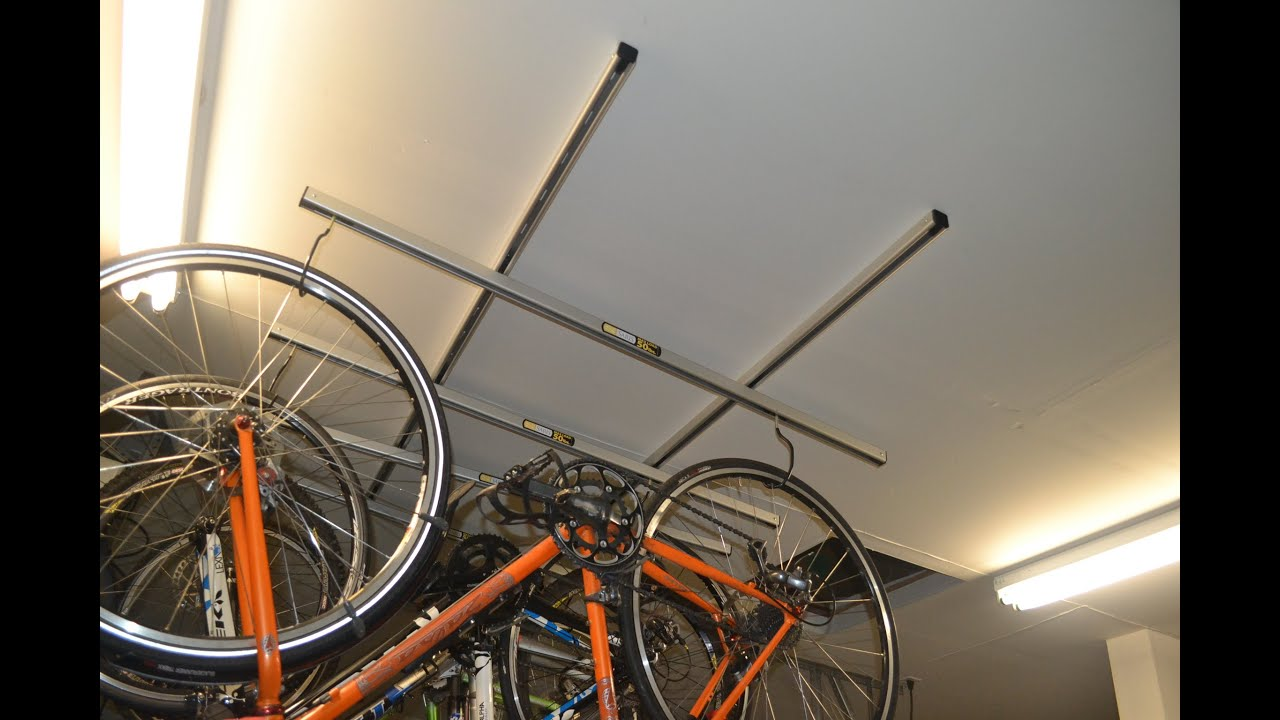lift bike furniture ceiling overhead with and garage mounted white ideas storage wall panels wood rack cabinet