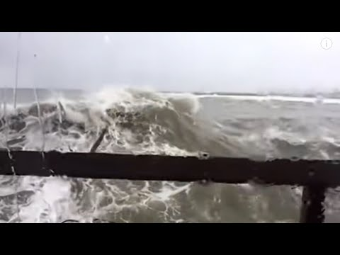 Rogue wave crashes headon through restaurant window after breakfast, 1st person view