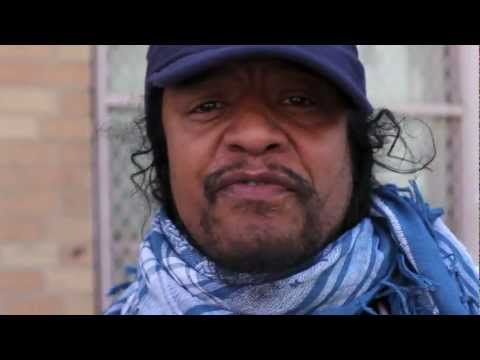 Maxi Priest wears the Israeli Keffiyeh