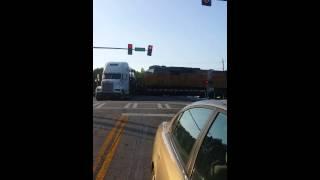 Truck get stuck on train tracks.