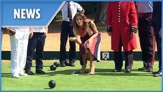 Melania Trump tries her hand at bowls during UK visit