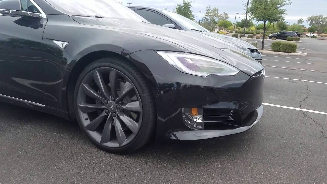 New 2016 Tesla With Auto Drive And 2015 Toyota Corolla S Lowered Customized Black Rims