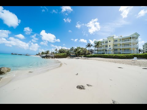 Charming Beachfront Condo in Nassau, Bahamas | Damianos Sotheby's International Realty