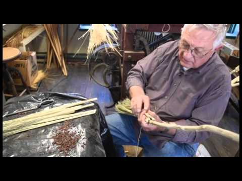 Making a broom by hand with broom corn