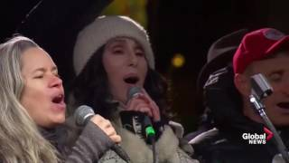 Celebrities come together to sing a song during anti-Trump rally