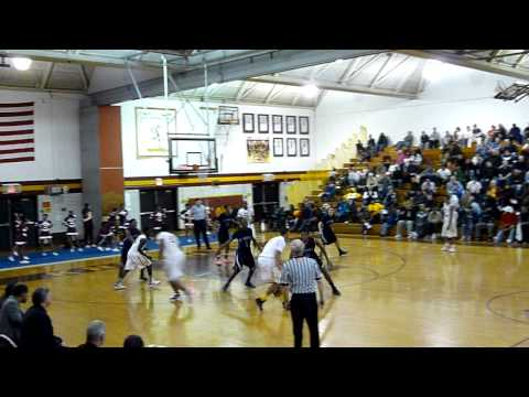 Mount Vernon's Isaiah Cousins hit a three from the top of the arc as the top-seeded Knights defeated the Huguenots, 74-59, in the quarterfinals of the 2012 Class AA playoffs.
