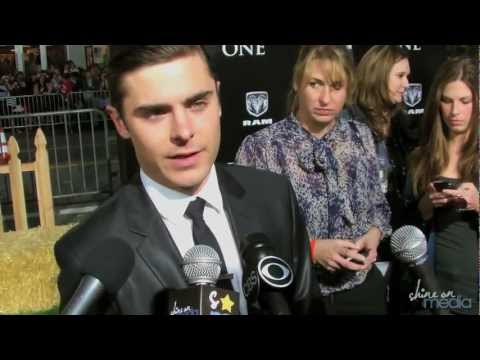 """The Lucky One"" Premiere Interviews - Zac Efron Taylor Schilling"
