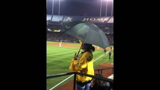 Woman Hilariously Wields Umbrella on Cloudless Night at Pivotal ALDS Oakland A's Game