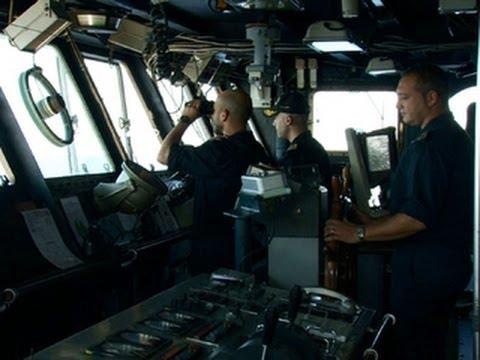 Italian coast guard works to save migrants at sea