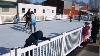 People skating on Synthetic Ice Skating Rink