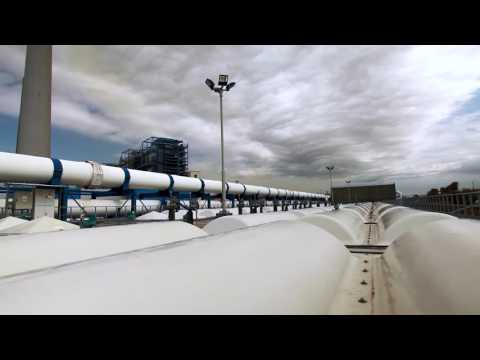 Stock Video Footage of a desalination plant's white pipeline in Israel.