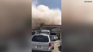 Momento en que varios edificios en México se derrumban por el terremoto thumbnail