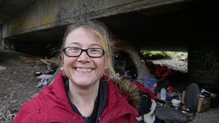 Living under a bridge doesn't stop this homeless woman from staying positive.