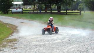 3 year old on 4 wheeler doing brodies