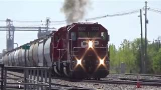 CP B60 Pulls a long string of cars  over UP diamond Clinton, IA May 4, 2019