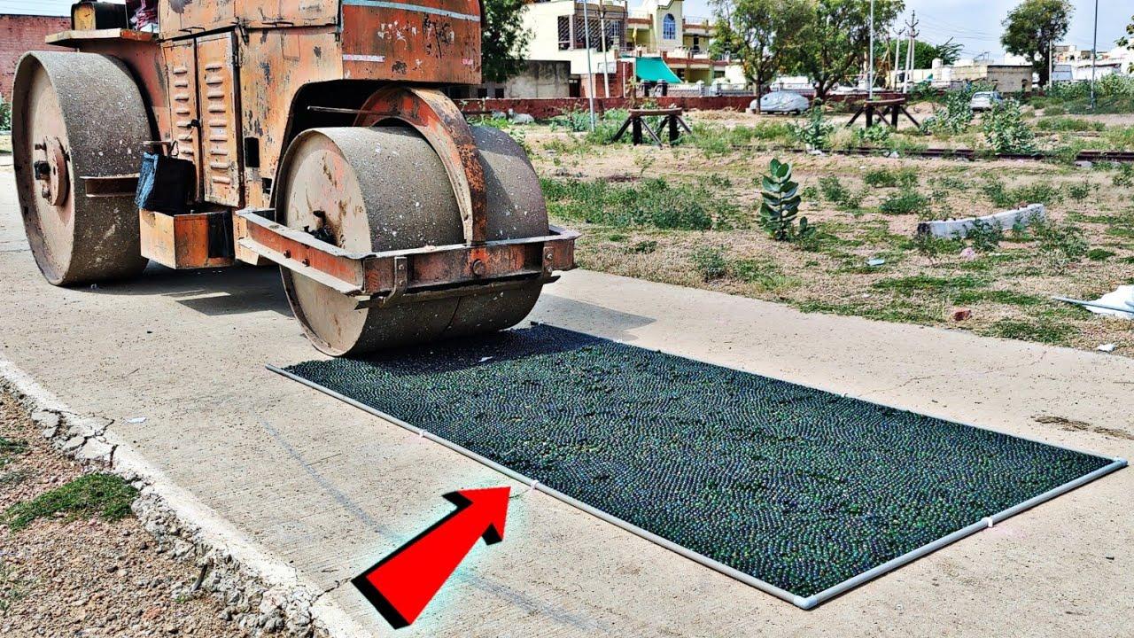रॉड रोलर को चला दिया काँच के कंचो पर - Driving Road Roller On Glass Marbels