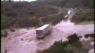 Tecate Truck Crossing Flooded River