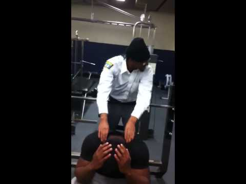 Nassau community college football players benching