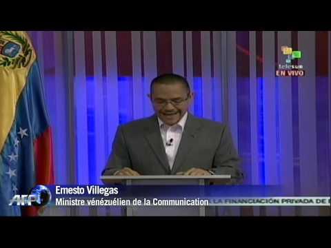 Venezuela_ Caracas diffuse des photos de Chavez_2 (HD)