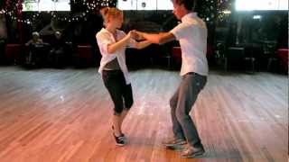 Tues Blues Denver Co teachers Ben Collins and Jessica Miltenberger dance together