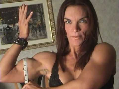 Tina Jo Orban measuring her muscles