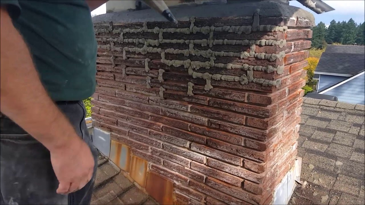Tamosealing And Tuck Pointing A Chimney You