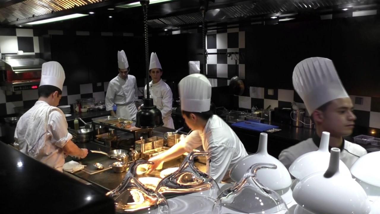 busy kitchen. busy kitchen at restaurant la grande maison by pierre gagnaire
