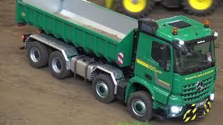 Mercedes Arocs loads a tipper body flat